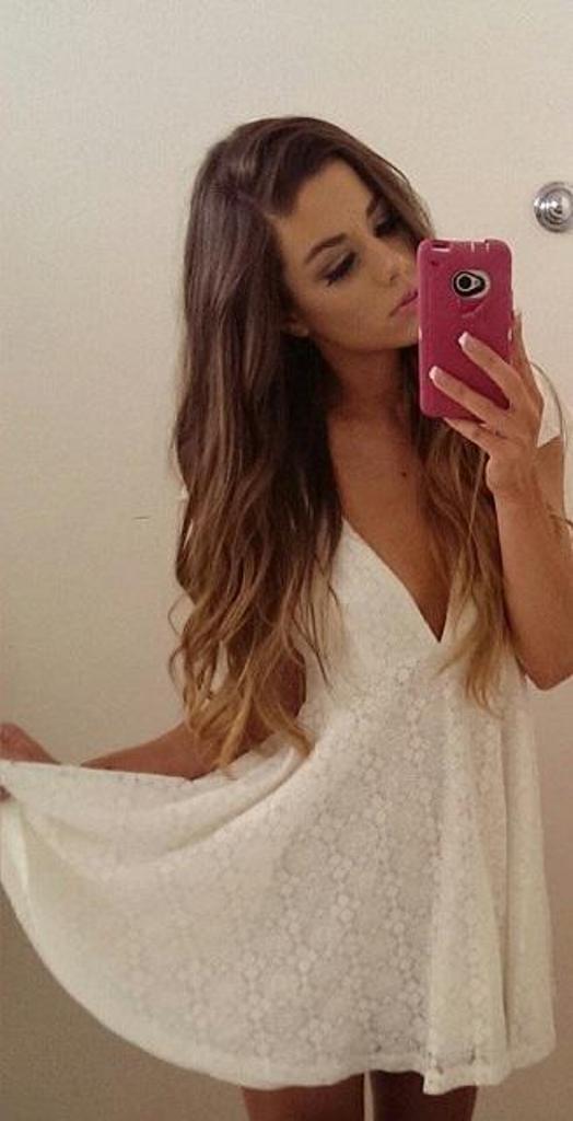 Katie standing In White Dress.