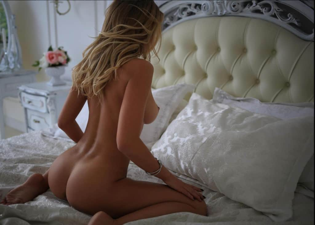 Lauren Kneeling On Bed Showing Her Butt