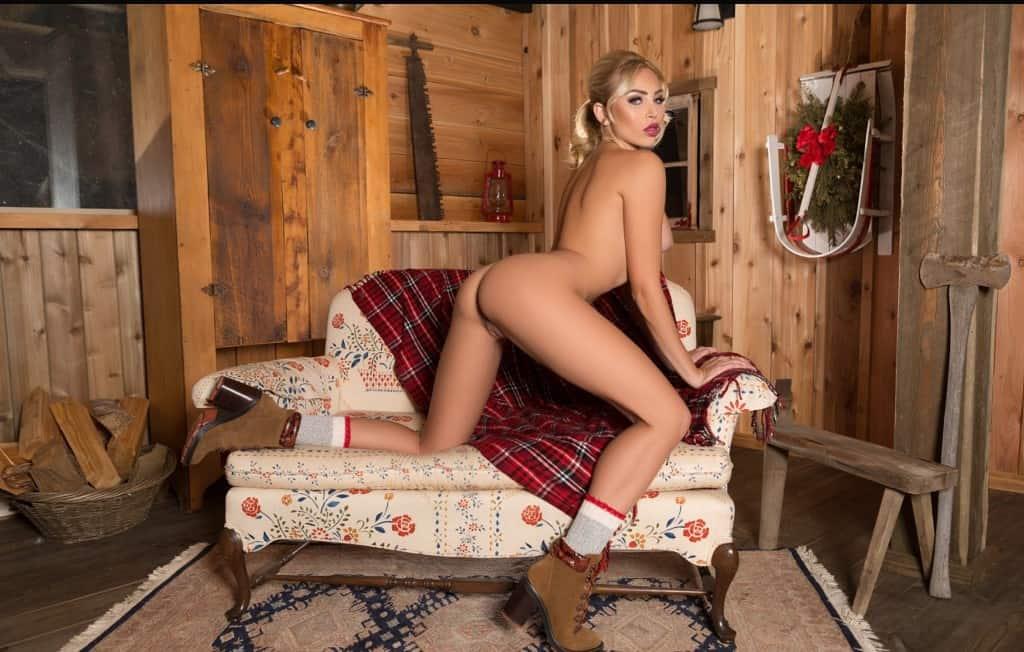 Tara kneeling On Couch In Hoorn
